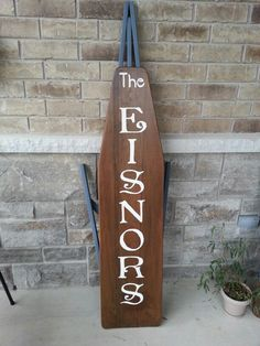 Last name welcome sign on a vintage ironing board #repurpose #diy #vintage
