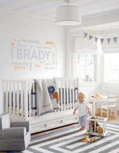 Gray & orange baby boy nursery. Love the wall decor!