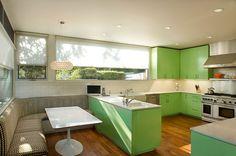 Pistachio green midcentury-style kitchen.