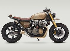 the walking dead custom motorcycle has an oxidized-styled finish, and handmade canvas bag appropriate for the TV show.