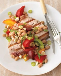 Repair free-radical damage by feasting on a potent antioxidant-packed blend of tomatoes, grilled tuna, and white beans. Torn tarragon leaves and a squeeze of lemon juice complement the dish's complex flavor.