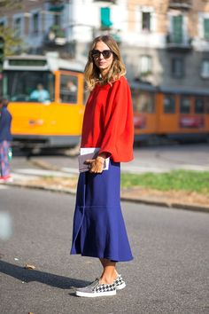 The new take on color blocking goes well because the blue skirt is like a neutral compared to the bright orange top.