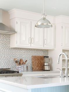 Install shimmering mosaic tiles to add a splash of style to your kitchen