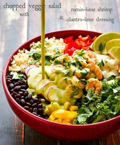 This Chopped Salad Recipe is filled with all good things and packed with flavor! Topped with Cumin Lime Shrimp and tossed with a Cilantro Li...