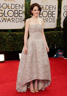 "Michelle Dockery of ""Downton Abbey"" walks the red carpet."