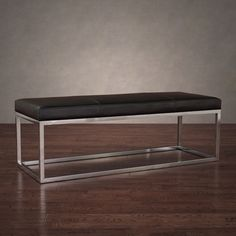 This trendy bench features a stainless steel frame supporting a modern black leather upholstery. This stylish and contemporary bench will complement your home decor, while lending extra seating to your living space.