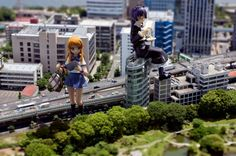 tilt shift in the city and add people to the scene in photoshop. not fake dolls like this.