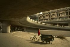 A view beneath the modern architecture and infastructure of the heart of the city. Stuart Franklin, Magnum Photos, Color Photography, Beijing, Cinematography, Modern Architecture, Portrait, City, Heart