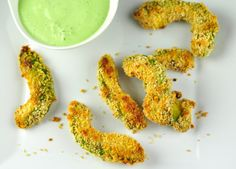 Avocado fries is an easy and healthy snack tastes crispy on the outside and soft inside. Sliced avocado coated with bread crumbs and baked. Healthy Finger Foods, Healthy Fruits, Healthy Snacks, Eating Healthy, Indian Food Recipes, Vegetarian Recipes, Snack Recipes, Cooking Recipes, Baby Recipes