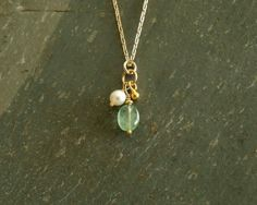 Genuine Columbian emerald, freshwater pearl necklace, 14K goldfilled   https://www.etsy.com/shop/bluegreenjewels