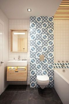 Gorgeous mosaic teal tiles in this bathroom