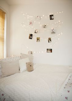 Make a photo feature wall with some warm white fairy lights, photos and a few wooden pegs!