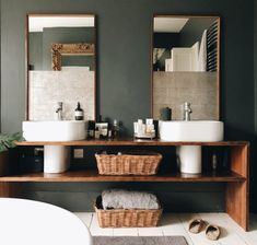 has created the bathroom of dreams! The his and her sinks were originally freestanding but to create extra storage they built shelves out of old reclaimed wood! We love the green walls and the white flooring, it all works together so w Wood Bathroom, Downstairs Bathroom, Modern Bathroom, Small Bathroom, Master Bathroom, Green Bathrooms, Green Bathroom Decor, Bathroom Images, Brown Bathroom
