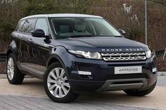 Navy blue Range Rover Evoque.
