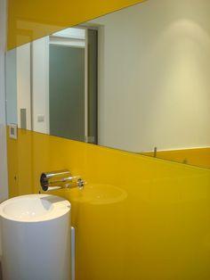 Splash of colour? Try yellow glass splashback for your bathroom! www.glass-houseuk.co.uk