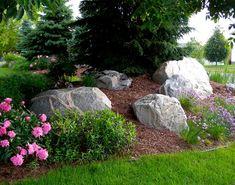 Boulders flower bed