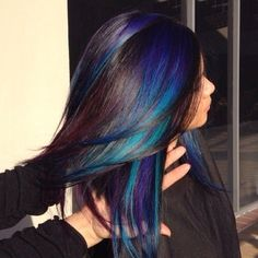 Gorgeous peacock haircolor with blue green and purple