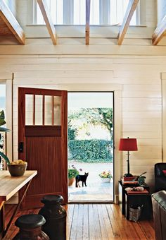 Light and Bright  The entry way leads to an airy living space with an opening in the ceiling for more light from the second-story windows. The original heart-pine flooring was preserved and the horizontal siding on the walls was coated with 10 layers of pickling stain ...