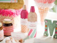 Glittered Whipped Cream Cans. Cute idea for a party.