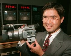 Vice President Jay Sato holds the company's digital handycam camcorder Film Tips, Vintage Tv, Video Film, Vice President, Video Camera, Video Photography, Camcorder, Filmmaking, Documentaries