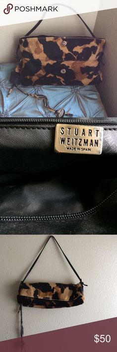 Stuart Weitzman Pony Hair Handbag Beautiful Stuart Weitzman Pony Hair Handbag.     Can be worn two ways. Folds into a small bag or extends for more room.                                    Previously owned but in Like New condition.           Hardly worn Gently Used. .                          Trading. Stuart Weitzman Bags Shoulder Bags