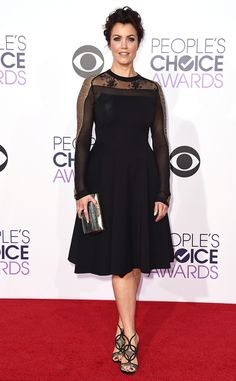 Bellamy Young from 2015 People's Choice Awards Red Carpet Arrivals  In a poised black dress with a sheer detailed bodice, the Scandal star is refined and chic.