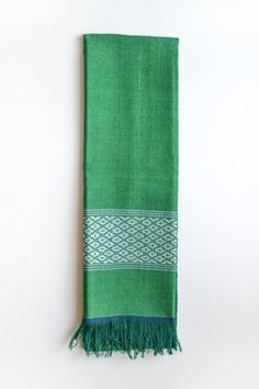 Handmade by artisanal weavers in Ethiopia using organic cotton, silk and traditional techniques Azola presents the Emerald Green Scarf. Let this stylish