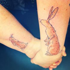 """Me (right) and my mam got matching Guess How Much I Love You tattoos as it was my favourite book as a child - I got Big Nutbrown Hare on my forearm for her and she got Little Nutbrown Hare on her wrist for me, so they look at each other when we hold hands. Done by Paul Heatlie at Hype 2 in Newcastle, England."""