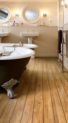Wood effect Colonia Golden Koa luxury vinyl tile flooring with Brown feature strip creating naval plank effect.