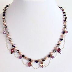Cattyleya: 17″ Purple Crystal Necklace #GameofThronesInspired $68.00  Add some fantasy to your day with this feminine statement piece. It will co-ordinate beautifully with the color of the year, radiant orchid and go from whimsical day wear to alluring evening attire. http://earthandmoondesign.com/shop/etherea/cattyleya-17-inch-purple-crystal-necklace/