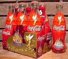 Six pack of Coca-Cola in glass bottles, commemorating Disneyland's 50th Anniversary, 2005.