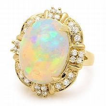 14K Yellow Gold 11.00CT Opal and Diamond Ring.