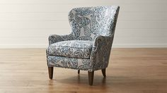 A wing chair, also known as a cool chairs wingback that is usually fully upholstered in fabric or leather, and has wings that go from arms of chair back. Furniture, Accent Chairs, Red Chair, Counter Height Chairs, Family Living Rooms, Wingback Chair, Chair, Black Dining Room Chairs, Cool Chairs