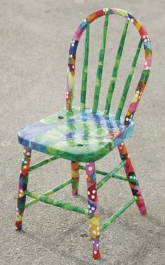 I think I can whip this up over the summer.  I have an old chair just like this.  It looks like a lot of tissue paper modge podged on.  I am the QUEEN of Modge Podge!!!