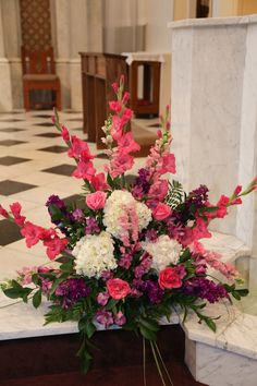 The church alter sprays were pink gladiolus, white hydrangea, pink roses, pink lisanthus , purple and pink stock.