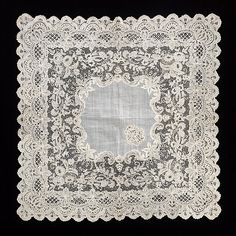 """Handkerchief - needle lace """"This complex and attractive combination of styles exemplifies the high-quality Belgian lace of the late 19th century"""" Date: third quarter 19th century Culture: French Medium: cotton, linen Dimensions: 16 x 16 in. (40.6 x 40.6 cm) Credit Line: Brooklyn Museum Costume Collection at The Metropolitan Museum of Art, Gift of the Brooklyn Museum, 2009; Gift of Joseph McCrindle, 1963 Accession Number: 2009.300.2861"""