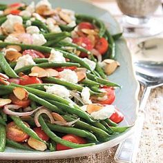 Green Beans with Goat Cheese, Tomatoes, and Almonds   My notes: Sub feta, add bacon, no almonds, shallots