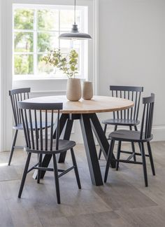 The contemporary Clockhouse Dining Table has a beautiful Raw Oak top and painted Carbon legs