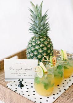 Fresh pineapple mojitos are sure to make a splash at your reception! Not a mojito fan, not a problem, here are several other ideas for pinapple themed cocktails.  Image found on Southern Weddings