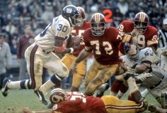 Giants Vs Redskins circa 1960's. I'm going to take an educated guess and say the Giants RB is Joe Morrison?