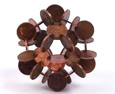 Interlocked Coins Form Complex Geometric Sculptures - My Modern Metropolis