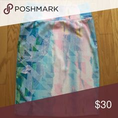 LuLaRoe Cassie Skirt - Pastel Watercolor - Large This is a new LuLaRoe pastel watercolor splash design Cassie skirt in size Large. No tags attached and comes from a smoke free and pet free home. It is a bright and colorful pastel pattern with triangle shape imprints. Amazing for summer with a simple white t-shirt. I love the skirt but it is unfortunately too big for me. Please refer to LuLaRoe size charts for details on sizing. LuLaRoe Skirts Pencil