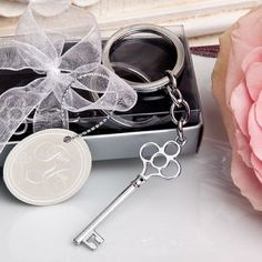 "Charming Key Chain Favor - Classic skeleton key design charm & ring measure 4"" x 1.125"".  Sturdy silver metal chain and ring.  Packaged in a clear-topped box, with black paper insert and silver base. http://www.favorfavor.com/page/FF/PROD/6128"
