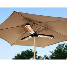 AZ Patio Heater Electric Umbrella Heater > Durable steel electric heater with black finish halogen bulb; Backyard Playground, Backyard Patio, Backyard Landscaping, Patio Roof, Landscaping Around Pool, Backyard Fireplace, Backyard Camping, Propane Patio Heater, Outdoor Heaters