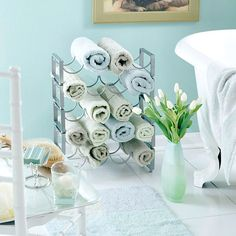 WINE RACK: I love creative storage! Re-purpose a wine rack as a functional, decorative towel rack. Great, I have a purpose for my old wine rack! Bathroom Towel Storage, Bathroom Towels, Kitchen Towels, Boy Bathroom, Bathroom Accents, Bathroom Closet, Pool Towels, Master Bathroom, Wine Rack For Towels