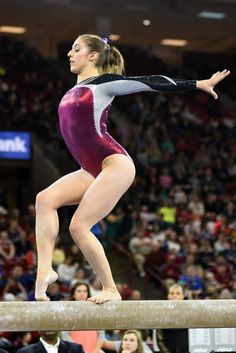 University of Denver gymnast Alix Angelopulo holds a pose during her beam routine. Photo taken on March 7, 2015, in Magness Arena at DU.