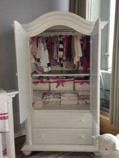 No closet in the nursery, so this Baby Cache armoire holds all of the baby's cute clothes.