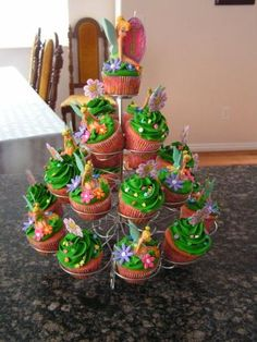 Tinkerbell Cupcakes on a Cupcake Tower Tinkerbell Party Theme, Fairy Birthday Party, 3rd Birthday Parties, Birthday Ideas, Pixie Hollow Party, Peter Pan Party, Fairy Cakes, Childrens Party, Cupcake Cakes