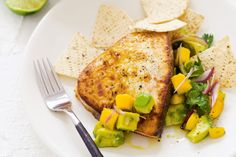 For a fresh and fast Mexican-inspired meal, try this recipe for swordfish steaks and mango guacamole.