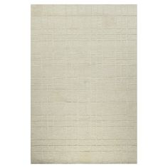 Hand-tufted wool rug in ivory with a geometric motif.   Product: RugConstruction Material: 100% WoolColo...